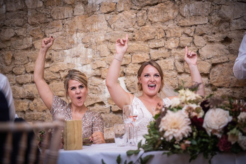 Bride with sister during wedding speech