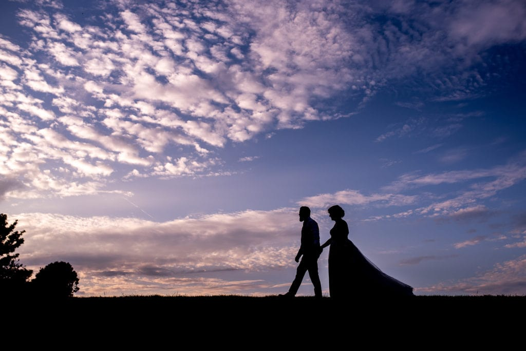 silhouette of newly married couple at sunset